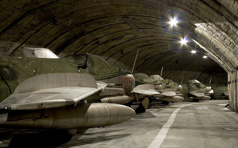 Two views of some of the F-6s stored in the underground tunnel at