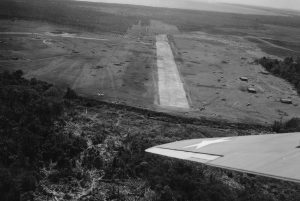 Transport aircraft is about to land on Henderson Field on August 22, 1942