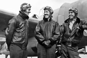 Guadalcanal pilots Smith, Mangrim and Carl in flight jackets not normally required on Guadalcanal